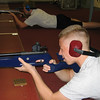 Nicholas and Blanton fire at targets from the prone position.