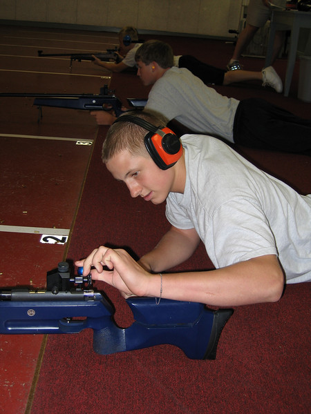 Hower checks the rifle during his rotation in the prone position.