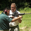 MAJ Blanchetti works with Cao on the proper way to handle the weapon on the outdoor range.