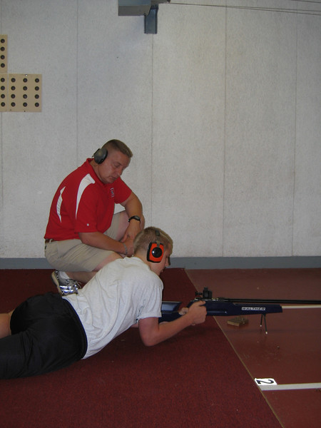 MAJ Blanchetti instructs Hower on the finer points of the prone shooting position.