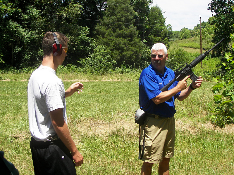 CPT Eldridge gives some tips to Cafferty on the outdoor range.