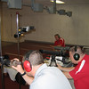 MAJ Blanchetti, MAJ Devault, and CPT Benson watch over the students as they practice their shooting in the indoor range.