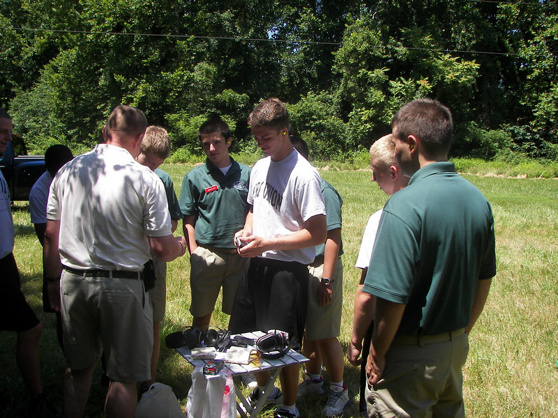 The students learn to properly load ammunition.