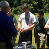 CPT Eldridge helps teach the students how to properly load ammunition.