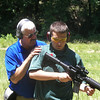 CPT Eldridge works with Grigsby on his stance on the outdoor range.