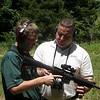 MAJ Blanchetti provides instruction to Blanton on the outdoor range.