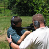 MAJ Blanchetti helps Grigsby learn the proper stance on the outdoor range.