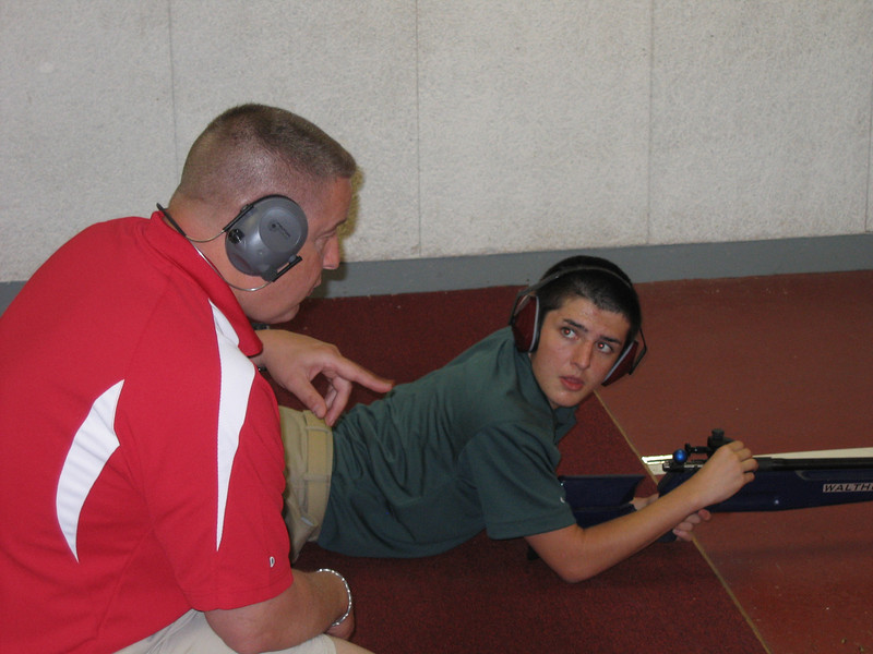 MAJ Blanchetti works with Andrews in the indoor range.