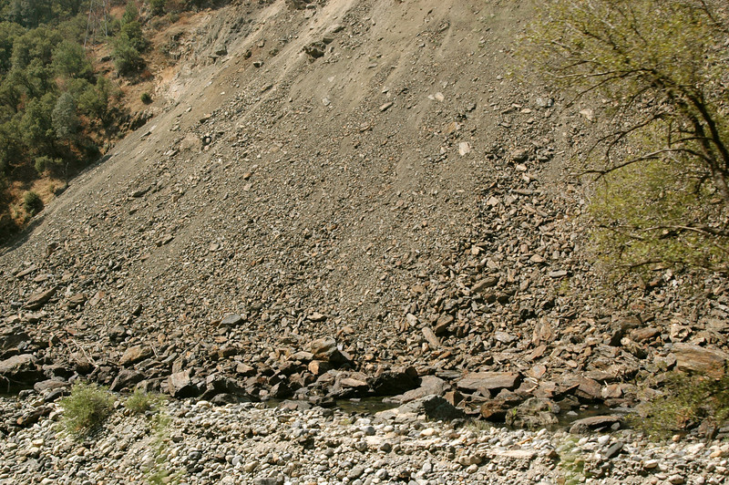 """This is just the tip of the Rock Slide! It goes on for hundreds of feet! As you can see the slide went right into the riverbed below!<br /> <br /> The miracle is that there was no loss of life in this slide, or so we have been told. My question is, """"Since the existing roadway is still covered by the slide, how, do they know for certain that no one is under there?"""" I mean, how could you tell? The entire roadway along the mountain is UNDER the slide debris! And it goes on for what seems like forever!<br /> Really kind of scary…"""