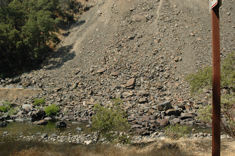 "This is just the tip of the Rock Slide! It goes on for hundreds of feet! <br /> To the left of this image, you can just make-out a portion of the roadway, or at least, what is left of it!<br /> The miracle is that there was no loss of life in this slide, or so we have been told. My question is, ""Since the existing roadway is still covered by the slide, how, do they know for certain that no one is under there?"" I mean, how could you tell? The entire roadway along the mountain is UNDER the slide debris! And it goes on for what seems like forever!<br /> Really kind of scary…"