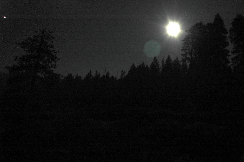 Standing and looking behind us from the fires, looking up at the full moon…