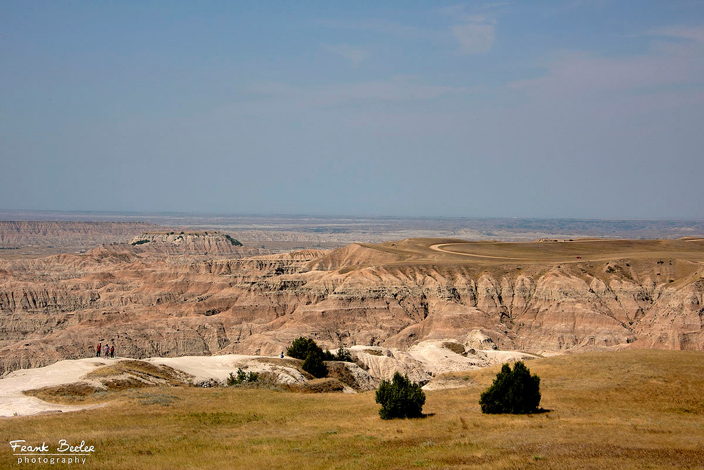 Badlands National Park is in South Dakota. Its dramatic landscapes span layered rock formations, steep canyons and towering spires. Bison, bighorn sheep and prairie dogs inhabit its sprawling grasslands.