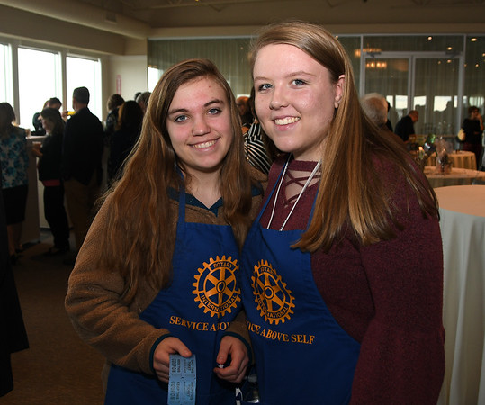 JIM VAIKNORAS/Staff photo newburyport High School students Sophie Scali and Logan Lattine sell raffle tickets at the Rotary Club of Newburyport annual Chef's Table Dinner at Sea Glass in Salisbury, featuring a three-course dinner prepared tableside by local chefs.