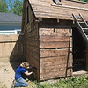JIM VAIKNORAS/Staff photo Dana Etherington owner of Dana's Workshop and his wife Dana Martin Etherington disassemble a shed.