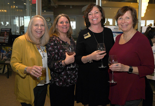 JIM VAIKNORAS/Staff photo Jill Ramsdell, Robin Sytulek, Kimberly Codair and Beth Desmarais of Atria at the Rotary Club of Newburyport annual Chef's Table Dinner at Sea Glass in Salisbury, featuring a three-course dinner prepared tableside by local chefs.