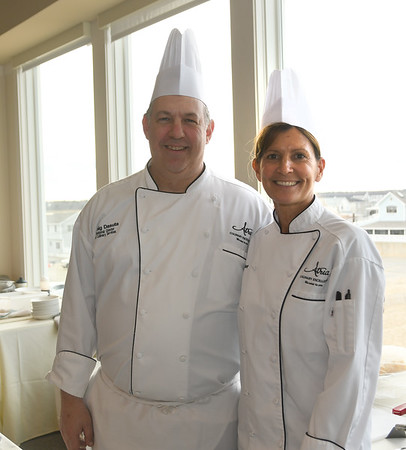 JIM VAIKNORAS/Staff photo Craig Dasuuta and Sherri Goulet of Atria at the Rotary Club of Newburyport annual Chef's Table Dinner at Sea Glass in Salisbury, featuring a three-course dinner prepared tableside by local chefs.
