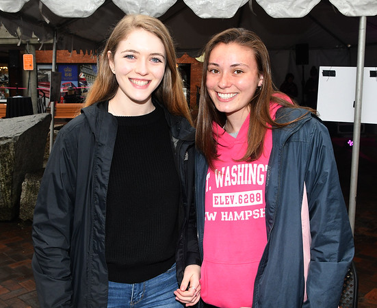 JIM VAIKNORAS/Staff photo Volunteers Kiara O'Malley and Shay Hawley sell tickets during Newburyport Spring Invitation Night.