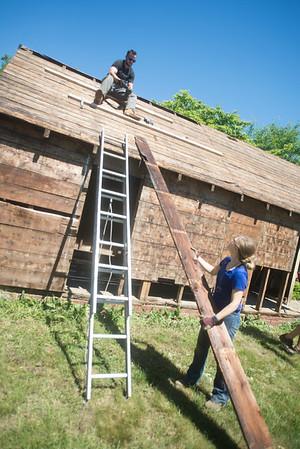 JIM VAIKNORAS/Staff photo Dana Etherington owner of Dana's Workshop and his wife Dana Martin Etherington disassemble a shed.