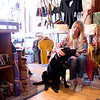JIM VAIKNORAS/Staff photo Amanda Perkins owner of Vaalbara in Newburyport with her dog and store fixture Vader.