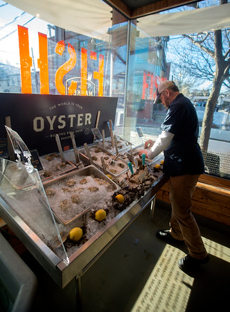 JIM VAIKNORAS/Staff photo Fred Derr checks the oysters at Fish in Newburyport.