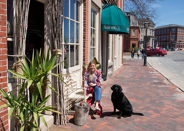 JIM VAIKNORAS/Staff photo Amanda Perkins owner of Vaalbara in Newburyport with her dog and store fixture Vader.