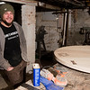JIM VAIKNORAS/Staff photo Dana Etherington of Dana's Workshop in his basement workshop.
