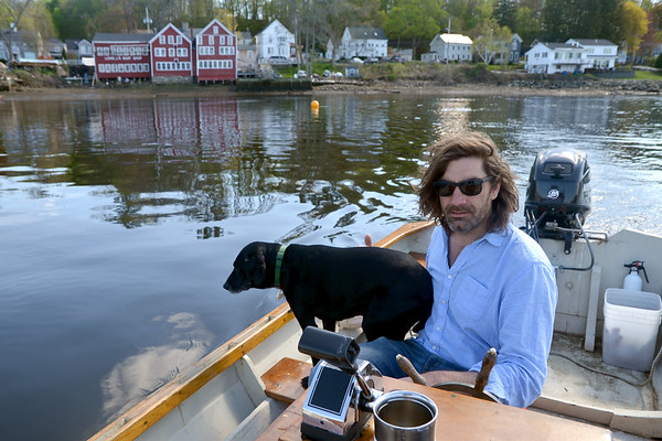 JIM VAIKNORAS/Staff photoMaster Boat Builder Graham McKay with his dog Niki at Lowells Boat Shop in Amesbury.