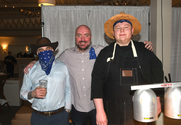 JIM VAIKNORAS/Staff photo  Paul Rose jr, Shaun O'Connor and Ryan Maloney of Brick and Ash at the Anna Jaques Hospital Aid Association Great Chefs' Night Boots & Scrubs.