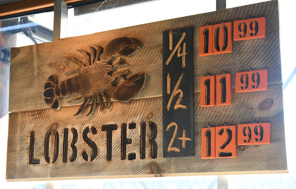 JIM VAIKNORAS/Staff photo Lobster sign at Fish in Newburyport.