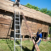 JIM VAIKNORAS/Staff photo Dana Etherington owner of Dana's Workshop and his wife Dana Martin Etherington disassemble a shed.  The shed was at his grandmother house in Newburyport and has provided wood for a number of projects.
