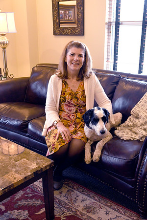 JIM VAIKNORAS/Staff photo Attorney Elaine Dalton with her dog Skye at her Groveland office