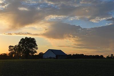 Sunlit Clouds at Dusk