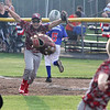 STAN HUDY - SHUDY@DIGITALFIRSTMEDIA.COM<br /> Mechanicville-Stillwater first baseman Zach Pingelski looks to join the celebration after catching the final out during the July 15, 2016 Little League 9-10 District 10_11 championship game at Mechanicville-Stillwater.
