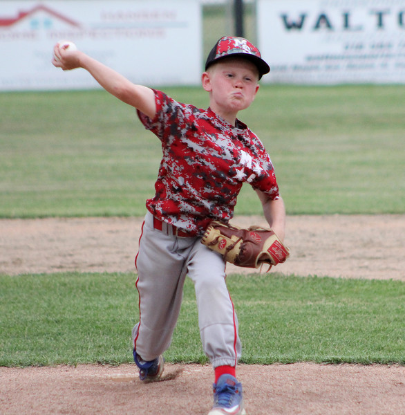 STAN HUDY - SHUDY@DIGITALFIRSTMEDIA.COM<br /> Mechanicville-Stillater Little League pitcher Fen Egan fires towards home early during the July 15, 2016 Little League 9-10 District 10_11 championship game at Mechanicville-Stillwater.
