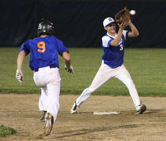 STAN HUDY - SHUDY@DIGITALFIRSTMEDIA.COM<br /> Saratoga Lightning shortstop Kyle Canavally looks to receive the ball and start the a sixth-inning double play that erased Clifton Park Gator Blue runner Max Baldyga running towards him Friday night during the Connie Mack Eastern New York State Tournament at the Clifton Common Baseball Complex.
