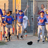 STAN HUDY - SHUDY@DIGITALFIRSTMEDIA.COM<br /> The Clifton Park Baseball League 9U Mets squad celebrates the game-winning sacrifice fly of Braden Mochrie that scored Jackson Bennice in extra innings in the rec championship game June 21.