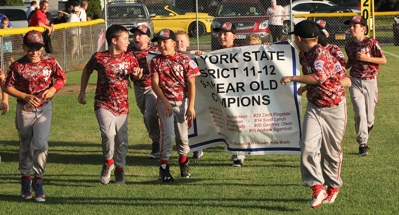 STAN HUDY - SHUDY@DIGITALFIRSTMEDIA.COM<br /> The Mechanicville-Stillwater 9- and 10-year-old all-stars finish circling their home field after capturing the District 11-12 championship with a 15-4 four inning victory over Saratoga National Friday night.
