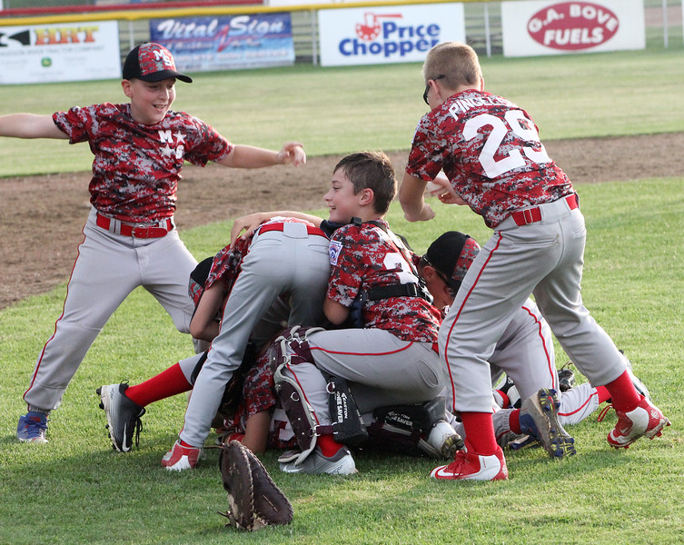 STAN HUDY - SHUDY@DIGITALFIRSTMEDIA.COM<br /> It's a Mechanicville-Stillwater dog pile celebration after the squad captured the July 15, 2016 Little League 9-10 District 10_11 championship game at Mechanicville-Stillwater.