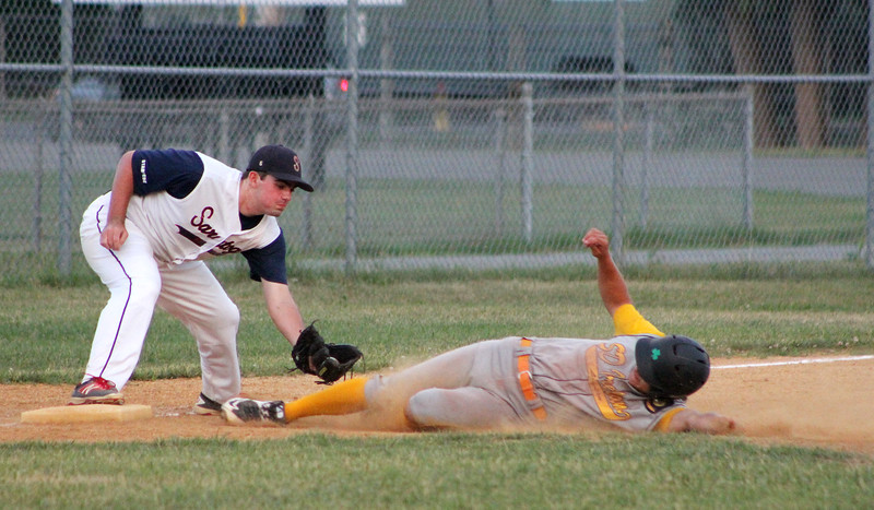 STAN HJDY - SHUDY@DIGITALFIRSTMEDIA.COM<br /> SD Ireland (Vermont) base runner Tyler Skaflestead is tagged out by Saratoga Stampede third baseman Ben Mason in the fourh inning Wednesday night at East Side Rec.