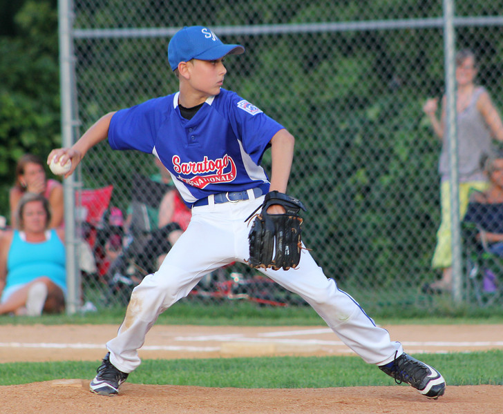 STAN HUDY - SHUDY@DIGITALFIRSTMEDIA.COM<br /> Saratoga National Little League starting pitcher Matt Sgambati fires towards home against Glens Falls Little League  during the District 11 championship game Saturday, July 16, at West Side Rec.