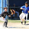 STAN HUDY - SHUDY@DIGITALFIRSTMEDIA.COM<br /> Wilton/Saratoga American base runner Sean Hudson heads home on a Brendan Young RBI single as North Colonie Blue catcher Ryan Goronsky awaits the throw. Hudson was safe on the play during the ENY 12U Cal Ripken semifinal.