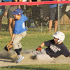 STAN HUDY - SHUDY@DIGITALFIRSTMEDIA.COM<br /> Clifton Park Baseball League 10U Yankee runner Ryan Green slides safely into third base on a steal attempt in the bottom of the sixth inning against the Blue Jays. He would score the tying run on the next play.