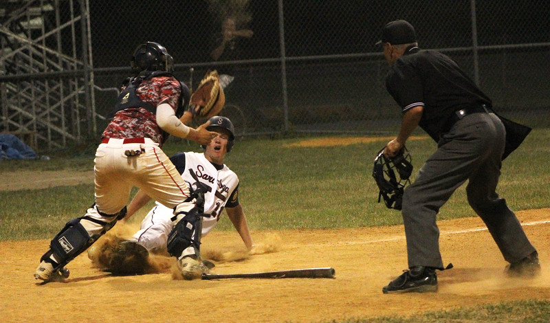 STAN HUDY - SHUDY@DIGITALFIRSTMEDIA.COM<br /> Saratoga Stampede base runner Zac Cronk comes in under the tag of Granville catcher Christian Pazabut in the second inning duirng Thursday night's Coopers Cave Tournament contest. He was safe on the play.