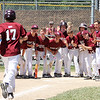 STAN HUDY - SHUDY@DIGITALFIRSTMEDIA.COM<br /> Greg Wescott has the Burnt Hills-Ballston Lake squad waiting for him after delivering the game-tying solo home run in the bottom of the sixth inning Saturday during the Cal Ripken Eastern New York State Tournament at Boght Road Baseball Complex in Latham.