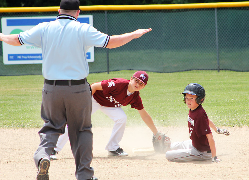 STAN HUDY - SHUDY@DIGITALFIRSTMEDIA.COM<br /> Kingston base runner Cam Potter and Burnt Hills-Ballston Lake shortstop John Wells both look up to the umpire after Potter's steal attempt Saturday afternoon at the Cal Ripken Baseball Eastern New York 12U tournament pool play game at Boght Road Baseball Complex in Latham.