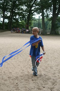 Explorer Jacalyn grabs some streamers for a superhero fortress.