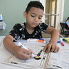 Daily kids have fun during the Summer Eats Program at the Silver Leaf Apartments in Leominster. Doing some coloring at the program is Josiah Crespo, 6. SENTINEL & ENTERPRISE/JOHN LOVE