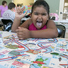 "Daily kids have fun during the Summer Eats Program at the Silver Leaf Apartments in Leominster. Having some fun playing ""Boston Ships and Ladder's"" game at the program is Abdielyz Espinal, 6. SENTINEL & ENTERPRISE/JOHN LOVE"