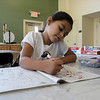 Daily kids have fun during the Summer Eats Program at the Silver Leaf Apartments in Leominster. Doing some coloring at the program is Mayah Rios, 6. SENTINEL & ENTERPRISE/JOHN LOVE