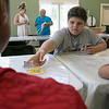 Daily kids have fun during the Summer Eats Program at the Silver Leaf Apartments in Leominster. Playing some Uno during the program is Edris Mercado, 12. SENTINEL & ENTERPRISE/JOHN LOVE